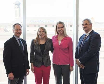 Pictured from left are Kevin McCurren, executive director of the Center for Entrepreneurship and Innovation, Leah Bauer, Kathryn Christopher and Paul Plotkowski, dean of the Padnos College of Engineering and Computing.